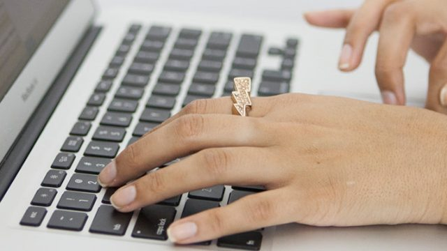 Typing out an email on a laptop
